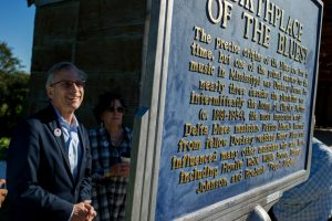 National Endowment for the Humanities chairman Bro Adams views the blues marker at Dockery Farms during a recent visit to the Mississippi Delta.