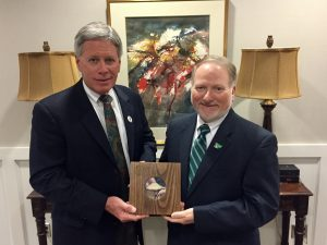 President LaForge (left) and Dr. McAdams with the centennial gift from Perm State University.