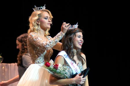 Gillian Oakley, left, passes the crown to 2017 Miss DSU, Hannah Leflore.
